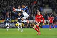 Manchester United Captain Patrice Evra controls the ball in the air.<br /> Barclays Premier League match, Cardiff city v Manchester Utd at the Cardiff city stadium in Cardiff, South Wales on Sunday 24th Nov 2013. pic by Phil Rees, Andrew Orchard sports photography,