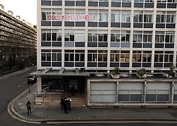 © Licensed to London News Pictures. 21/01/2012, London, UK.  Police stand outside the building. Occupy London protesters this morning publicly repossessed Roman House, an abandoned nine-storey office building in the Barbican. The Occupy London campaigners - part of the global movement for social and economic justice and real democracy - stated that they intend to occupy the building - their fifth occupation - until such time as the City of London Corporation publishes full details of its City Cash Accounts.  Photo credit : Stephen Simpson/LNP