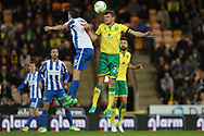Norwich City defender Ryan Bennett beats Brighton & Hove Albion winger Jamie Murphy (15) in the air during the EFL Sky Bet Championship match between Norwich City and Brighton and Hove Albion at Carrow Road, Norwich, England on 21 April 2017.