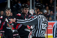 KELOWNA, CANADA - MARCH 14: Cameron MacPhee #28 of the Prince George Cougars is sent to the dressing room by linesman Dustin Minty after a third period line brawl with the Kelowna Rockets  on March 14, 2018 at Prospera Place in Kelowna, British Columbia, Canada.  (Photo by Marissa Baecker/Shoot the Breeze)  *** Local Caption ***