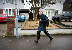 © Licensed to London News Pictures. 07/03/2017. London, UK. Shadow Chancellor John McDonnell runs for a bus as he leaves home on budget day.  Later Chancellor of the Exchequer Philip Hammond will deliver his 2017 Budget to Parliament. Photo credit: Peter Macdiarmid/LNP