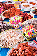 Colorful traditional natural snacks made from beans, seeds and nuts on sale at the Tuesday Market in San Miguel de Allende, Guanajuato, Mexico.