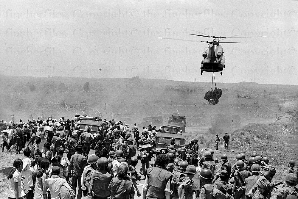 Evacuations near Xuan Loc in South Vietnam as the North Vietnamese army made their advance on the city. Xuan Loc was the last major battle of the Vietnam War fought between 9th and 21st April 1975. Photographed by award winning photographer Terry Fincher. Contact thefincherfiles@btinternet.com for publication fees and permissions.