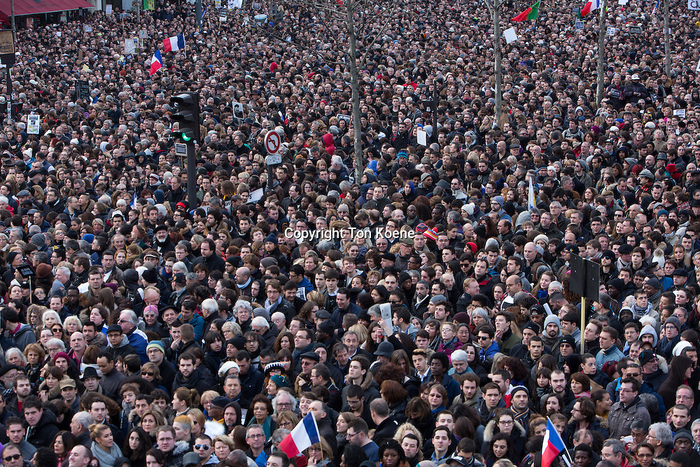 march in paris on 11 jan 2015 as protest against the killing of the Charlie Hesbo cartoonists.