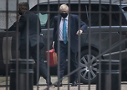© Licensed to London News Pictures. 19/10/2020. London, UK. Prime Minister Boris Johnson arrives at the back of Downing Street after a weekemnd at Chequers.  Photo credit: Peter Macdiarmid/LNP