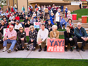 13 FEBRUARY 2012 - MESA, AZ:   Mitt Romney supporters wait for Romney to arrive at the Mesa Amphitheatre. Several thousand people crowded into the amphitheatre in Mesa, AZ, Monday night to hear Republican Presidential candidate Mitt Romney speak. Romney, a Mormon, is expected to win in Arizona, which has a large Mormon population. Arizona's Republican Presidential primary is February 28.      PHOTO BY JACK KURTZ  PHOTO BY JACK KURTZ