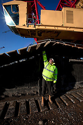 Olympic Stadium. Site supervisor Neil Doherty demonstrating the immense scale of the 13,500 tonne super lift crane. Prior to it's use for lifting the Stadium roof truss into place on top of the Stadium's steel rakers. Picture taken on 27 Jan 2009 by David Poultney.
