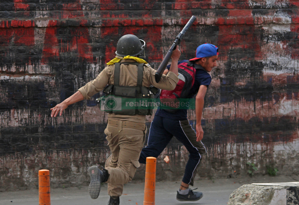 May 9, 2017 - Srinagar, Jammu and Kashmir, India - Clashes between Kashmiri students and Indian police in Srinagar, Kashmir on May 09, 2017. Indian police used teargas shells, chili smoke and stun grenades to disperse protesting students. The agitating students were protesting against last month's Indian police raid. (Credit Image: © Umer Asif/Pacific Press via ZUMA Wire)
