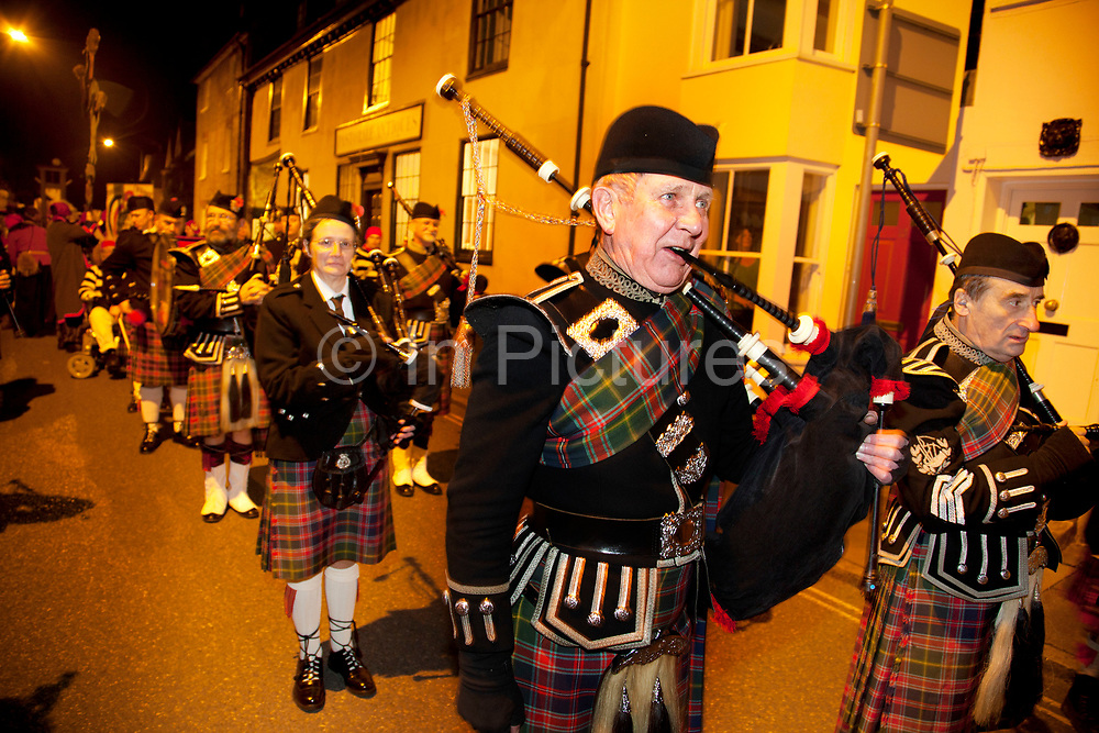 Lewes, UK. Monday 5th November 2012. Pipe band play during Bonfire Night celebration in the town of Lewes, East Sussex, UK which form the largest and most famous Guy Fawkes Night festivities. Held on 5 November, the event not only marks the date of the uncovering of the Gunpowder Treason and Plot in 1605, but also commemorates the memory of the 17 Protestant martyrs from the town burnt at the stake for their faith during the Marian Persecutions of 1555–57. There are six bonfire societies putting on parades involving some 3,000 people.