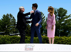 Prime Minister Justin Trudeau and wife Sophie Gregoire Trudeau greet President of the European Commission, Jean-Claude Juncker during the official welcoming ceremony at the G7 Leaders Summit in La Malbaie, Quebec, Canada on Friday, June 8, 2018. Photo by Sean Kilpatrick/CP/ABACAPRESS.COM