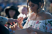 Grand National Meeting - Ladies' Day<br /> e.g. of caption:<br /> National Hunt Horse Racing - 2017 Randox Grand National Festival - Friday, Day Two [Ladies' Day]<br /> <br />   <br /> bookie pays out to a female racegoer in the 7th race Weatherbys Private Bank Standard Open NH Flat Race (Grade 2) (Class 1)2m 209y, Good<br /> 19 Runners.at Aintree Racecourse.<br /> <br /> COLORSPORT/WINSTON BYNORTH