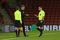 Football - 2019 / 2020 Emirates FA Cup - Third Round: Southampton vs. Huddersfield Town<br /> <br /> Referee Mr Tim Robinson swaps watches with fourth official Christopher Sarginson during the FA Cup tie at St Mary's Stadium Southampton<br /> <br /> COLORSPORT/SHAUN BOGGUST
