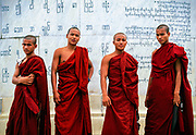 Young Buddhist monks stand at Independence Monument ¾ erected in 1948 replacing a statue of Queen Victoria ¾  in Yangon, capital of Myanmar.  Becoming a monk is a rite of passage for many young men in Myanmar, where at any one time there are a half-million Buddhist monks, novices, and nuns in a nation of only 53 million people. © Steve Raymer, 2002 / ALL RIGHTS RESERVED