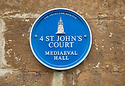 Blue plaque St John's Court originally a medieval hall building,  Devizes, Wiltshire, England, UK