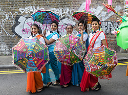 © Licensed to London News Pictures. 14/05/2017. LONDON, UK. <br /> Performers stop to pose for a photograph as they dance in the street during the Boishakhi Mela street parade festival along and around Brick Lane in east London to celebrate the Bengali New Year. The Boishakhi Mela in Tower Hamlets is the largest celebration of Bengali New Year in Europe, attracting performers and crowds of thousands of spectators from around the world. Photo credit: Vickie Flores/LNP