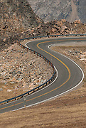 A road curves through the rocky landscape of the Beartooth Mountains in Montana and Wyoming. Missoula Photographer