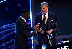 Peter Schmeichel (right) presents the award for Best FIFA goalkeeper during the Best FIFA Football Awards 2017 at the Palladium Theatre, London.
