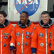 The crew of space shuttle Discovery, from left, mission specialist's Michael Barratt, Alvin Drew, Steve Bowen, pilot Eric Boe smile for cameras before the final flight of Discovery at the Kennedy Space Center in Cape Canaveral, Fla., Thursday, Feb. 24, 2011. (AP Photo/Alex Menendez)