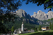 The church at Colfosco surrounded by Dolomites mountains, south Tyrol, Italy.