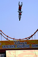 """Jul 01, 2003; Anaheim, California, USA; Moto X star athlete MIKE METZGER executing a tremendous stunt hands free with a full sized motobike over the Park's replica of the Golden Gate Bride for the opening of Disney's California Adventure """"X Games Experience"""".  Disney park has built two X-Arena's specifically for this 41 day event highlighting extreme sports for the launch of the 2003 ESPN X Games.<br />Mandatory Credit: Photo by Shelly Castellano/Icon SMI<br />(©) Copyright 2003 by Shelly Castellano"""
