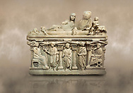 """Roman relief sculpted sarcophagus of Aurelia Botiano and Demetria depicted reclining on the lid, 2nd century AD, Perge Inv 1.35.99. Antalya Archaeology Museum, Turkey.<br /> <br /> it is from the group of tombs classified as. """"Columned Sarcophagi of Asia Minor"""". The lid of the sarcophagus is sculpted into the form of a """"Kline"""" style Roman couch on which lie Julianus &  Philiska. This type of Sarcophagus is also known as a Sydemara Type of Tomb.. Against a warm art background..<br /> <br /> If you prefer to buy from our ALAMY STOCK LIBRARY page at https://www.alamy.com/portfolio/paul-williams-funkystock/greco-roman-sculptures.html . Type -    Antalya    - into LOWER SEARCH WITHIN GALLERY box - Refine search by adding a subject, place, background colour, etc.<br /> <br /> Visit our ROMAN WORLD PHOTO COLLECTIONS for more photos to download or buy as wall art prints https://funkystock.photoshelter.com/gallery-collection/The-Romans-Art-Artefacts-Antiquities-Historic-Sites-Pictures-Images/C0000r2uLJJo9_s0"""