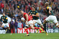 Gareth Davies of Wales runs with the ball. Rugby World Cup 2015 quarter final match, South Africa v Wales at Twickenham Stadium in London, England  on Saturday 17th October 2015.<br /> pic by  John Patrick Fletcher, Andrew Orchard sports photography.