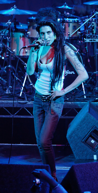 Singer Amy Winehouse, DOB=14/09/1983, performing for her gay fans at the G-A-Y Club. G-A-Y is London's biggest gay club and is held at the London Astoria nightclub, Soho, London, UK. Amy spent much of the show rubbing her itchy nose. She also seemed to have signs of old scars all down one arm...Picture Data:.Photographer: Edward Hirst.Copyright: ©2007 Licensed to Equinox News Pictures +448700 780000.Contact: Equinox Features.Date Taken: 20070415.Time Taken: 015502+0000.www.newspics.com