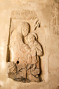 Early Anglo-Saxon stone carved figure of Virgin Mary and child Jesus Christ, church of Saint John, Inglesham, Wiltshire, England, UK