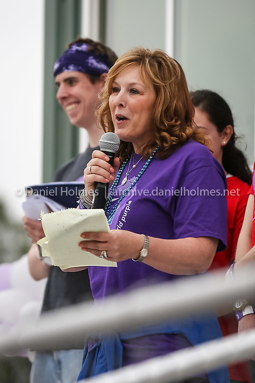 (5/13/16, HOPKINTON, MA) Survivor Marie Boyle, of Hopkinton, addresses attendees during the Hopkinton Relay For Life at the Hopkinton High School track on Friday. Daily News and Wicked Local Photo/Dan Holmes