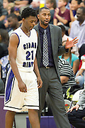 Cedar Ridge head coach, Coach Black and Jerrod Smith discuss strategy against San Marcos HS Friday.  The Raiders won it in overtime.  Final Score:  88-87.  (LOURDES M SHOAF for Round Rock.)
