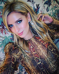 """Nicky Hilton releases a photo on Instagram with the following caption: """"\ud83d\udc0d"""". Photo Credit: Instagram *** No USA Distribution *** For Editorial Use Only *** Not to be Published in Books or Photo Books ***  Please note: Fees charged by the agency are for the agency's services only, and do not, nor are they intended to, convey to the user any ownership of Copyright or License in the material. The agency does not claim any ownership including but not limited to Copyright or License in the attached material. By publishing this material you expressly agree to indemnify and to hold the agency and its directors, shareholders and employees harmless from any loss, claims, damages, demands, expenses (including legal fees), or any causes of action or allegation against the agency arising out of or connected in any way with publication of the material."""