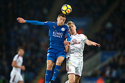 """Leicester City's Jamie Vardy (left) and Burnley's Ben Mee battle for a header during the Premier League match at the King Power Stadium, Leicester. PRESS ASSOCIATION Photo Picture date: Saturday December 2, 2017. See PA story SOCCER Leicester. Photo credit should read: Mike Egerton/PA Wire. RESTRICTIONS: EDITORIAL USE ONLY No use with unauthorised audio, video, data, fixture lists, club/league logos or """"live"""" services. Online in-match use limited to 75 images, no video emulation. No use in betting, games or single club/league/player publications."""