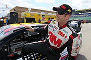 Greg Biffle after qualifying for the NASCAR Sprint Cup race at Kansas Speedway, Friday, April 19, 2013 in Kansas City, Kansas. (AP Photo/Colin E. Braley).