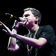 Rap artist Logic sings during the Verge Campus Spring Tour concert at the CFE Arena on the University of Central Florida campus, Tuesday, April 8, 2014, in Orlando, Florida.  (AP Photo/Alex Menendez)