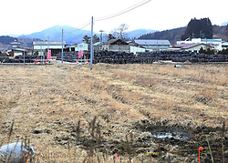 """Black bags containing buildup of contaminated wastes are seen in the town of Iitate, Fukushima Prefecture, Japan, March 7, 2015. The scenes from the towns and villages still abandoned four years after an earthquake triggered tsunami breached the defenses of the Fukushima Daiichi nuclear power plant, would make for the perfect backdrop for a post- apocalyptic Hollywood zombie movie, but the trouble would be that the levels of radiation in the area would be too dangerous for the cast and crew. The central government's maxim of """"Everything is under control"""" in and around the nuclear plant, has been a blatant lie since the disaster began to unfold on March 11, 2011, quickly escalating into the worst civilian nuclear crisis ever to happen, with twice the amount of radioactive materials being released into the environment than the Chernobyl disaster in 1986. EXPA Pictures © 2015, PhotoCredit: EXPA/ Photoshot/ Liu Tian<br /> <br /> *****ATTENTION - for AUT, SLO, CRO, SRB, BIH, MAZ only*****"""