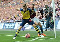 Arsenal's Aaron Ramsey battles with Aston Villa's Tom Cleverley<br /> <br /> Photographer Ian Cook/CameraSport<br /> <br /> Football - The FA Cup Final - Aston Villa v Arsenal - Saturday 30th May 2015 - Wembley - London<br /> <br /> © CameraSport - 43 Linden Ave. Countesthorpe. Leicester. England. LE8 5PG - Tel: +44 (0) 116 277 4147 - admin@camerasport.com - www.camerasport.com