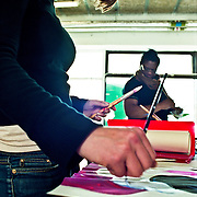 Female art student painting in art class.