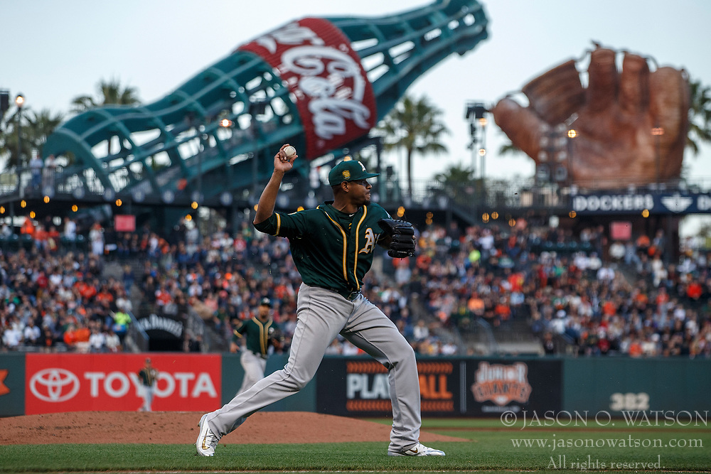 SAN FRANCISCO, CA - JULY 13: Edwin Jackson #37 of the Oakland Athletics throws to first base after fielding a ground ball against the San Francisco Giants during the first inning at AT&T Park on July 13, 2018 in San Francisco, California. The San Francisco Giants defeated the Oakland Athletics 7-1. (Photo by Jason O. Watson/Getty Images) *** Local Caption *** Edwin Jackson