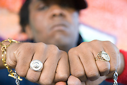 Man with his fists in front of camera showing rings and jewellery,