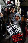A young Muslim woman protests at the Stop Trump's Muslim ban demonstration on 4th February 2017 in London, United Kingdom. The protest was called on by Stop the War Coalition, Stand Up to Racism, Muslim Association of Britain, Muslim Engagement and Development, the Muslim Council of Britain, CND and Friends of Al-Aqsa. Thousands of demonstrators gathered to demonstrate against Trumps ban on Muslims, saying it must be opposed by all who are against racism and support basic human rights, and for Theresa May not to collude with him.