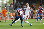 Yannick Bolasie of Crystal Palace crosses the ball over Ryan Shawcross, the Stoke City captain. Barclays Premier League match, Crystal Palace v Stoke City at Selhurst Park in London on Saturday 7th May 2016. pic by John Patrick Fletcher, Andrew Orchard sports photography.