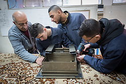 25 February 2020, Jerusalem: Teacher Gabi Kamel (left) leads students Mohammad, Mohammad and Abdel in constructing a window frame, during class in Aluminium work at the vocational training centre in Beit Hanina. The Lutheran World Federation's vocational training centre in Beit Hanina offers vocational training for Palestinian youth across a range of different professions, providing them with the tools needed to improve their chances of finding work.