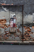 Brother and Sister on a Swing is one of the most noteworthy murals in George Town, Penang. It was created by Penang local Louis Gan a deaf- mute artist. The mural shows two children on a swing and celebrates the intimacy between siblings, as Louis had with his brother. The subjects of the mural are of the children of the building onto which it's painted, SBS Paper Products in the adjacent alley just off Chulia Street. It's joyous theme is a favorite of both locals and visitors of the many murals and street art on the streets and alleys of Penang.