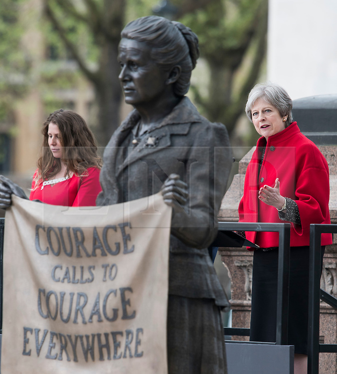 © Licensed to London News Pictures. 24/04/2018. London, UK. Campaigner Caroline Criado-Perez (left) and British Prime Minister Theresa May (right) speaking at the unveiling of a statue of Millicent Fawcett in Parliament Square, London. Dame Millicent, a leading Suffragist and campaigner for equal rights for women, is the first woman to be commemorated with a statue in Parliament Square. Photo credit: Ben Cawthra/LNP