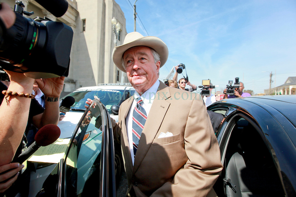 16 March 2015. New Orleans, Louisiana.<br /> Dick DeGuerin, (Brown suit with hat) Texas based lawyer for property billionaire Robert Durst gives brief statement to the assembled media outside Orleans Parish Criminal District Court following a hearing to extradite his client to Los Angeles. DeGuerin the jumped in a waiting car and was whisked away.<br /> Photo; Charlie Varley/varleypix.com