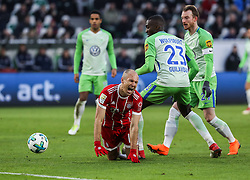 WOLFSBURG, Feb. 18, 2018  Bayern Munich's Arjen Robben (Front L) reacts after vying with Wolfsburg's Josuha Guilavogui (Front R) during a German Bundesliga match between VfL Wolfsburg and Bayern Munich, in Wolfsburg, Germany, on Feb. 17, 2018. Bayern Munich won 2-1. (Credit Image: © Shan Yuqi/Xinhua via ZUMA Wire)