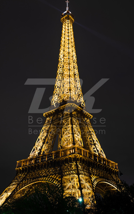 The Eiffel Tower is lit up once the sun sets in Paris, France on May 18, 2012.
