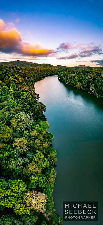 An aerial photograph of the Barron River, taken at sunset.<br /> <br /> Limited Edition of 125.<br /> <br /> Available as a fine art print, an acrylic face-mounted print, or as an alugraph.