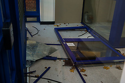 © Licensed to London News Pictures. 12/11/2020. London, UK. Broken door and shattered glass inside Edmonton Police Station in north London following an incident where a vehicle was driven into the police station just before 7pm on Wednesday, 11 November. A 45-year-old man left the vehicle before attempting to set fire to it using petrol. He was arrested by officers on suspicion of arson and is remanded in custody. The incident is not being treated as terror-related. Photo credit: Dinendra Haria/LNP