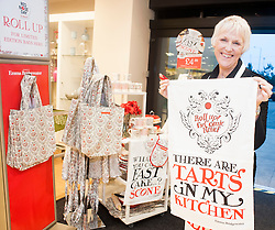 """Tricia Stewart, the original WI """"Calendar Girl""""  helps launch of Emma Bridgewater's stunning homeware range at HomeSense Leeds on Thursday afternoon.  Emma Bridgewater's exclusive range for Red Nose Day 2013 is available from HomeSense  and TK Maxx stores....7 March  2013.Image © Paul David Drabble"""